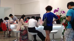 One side of Chinese travel agency. For people line up buying ticket stock footage