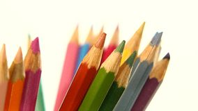 One side of colour pencils isolated on white stock video footage