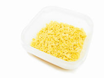 One side curled short-cut pasta in plastic contain Royalty Free Stock Images