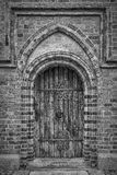 Roskilde Cathedral Door Monochromatic. One of the side doors to the cathedral at Roskilde in Denmark royalty free stock photos