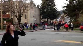 One side of firefighter crews battling apartment complex fire. Coquitlam, BC, Canada - February 16, 2015 : Firefighter crews battling apartment complex fire on stock video