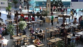 One side of food court at YVR airport. Top shot of food court at YVR airport stock footage