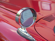 One side mirror on a red car Royalty Free Stock Image