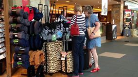 One side of passengers inside gift shop for buying luggage. At YVR airport stock video