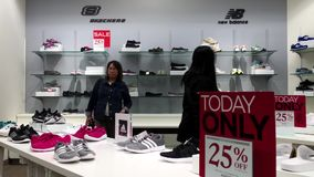 One side of people buying new shoes. Inside The bay store stock video