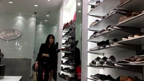 One side of people buying new shoes. Inside Steve madden shoes store stock footage