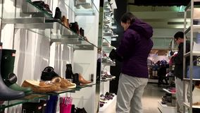 One side of people buying new shoes. Inside Steve madden shoes store stock video