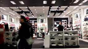 One side of people buying new shoes. Inside shoes store stock video