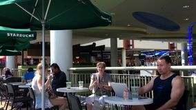 One side of people drinking coffee and chatting stock footage