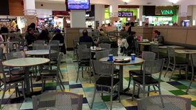 One side of people eating food at food court area stock video footage