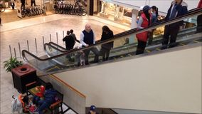 One side of people in fast motion moving escalator stock video footage