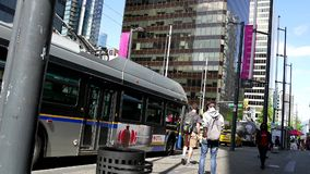 One side of people get off the bus. At downtown Vancouver stock video
