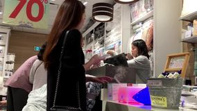 One side of people paying credit card for buying bedquilt. Inside mattress store stock video footage