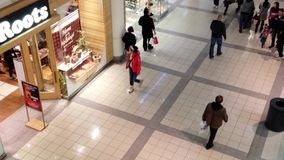 One side of people shopping inside Burnaby shopping mall stock video