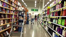 One side of people shopping inside Save on Foods. stock video