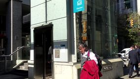 One side of people taking elevator. At downtown Vancouver stock footage