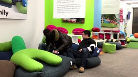 One side of people trying bean bags inside Yagibo store Royalty Free Stock Photos