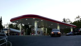 One side of Petro Canada gas station. stock video footage