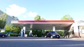 One side of several cars filling fuel. At Esso gas station stock video