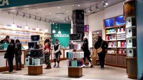 One side of shopper inside Davids tea store stock video footage