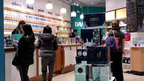 One side of shopper inside Davids tea store stock footage