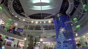 One side of shopping mall with Christmas light was decorated full of building stock video