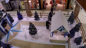 One side of shopping mall with Christmas tree decorated for xmas season stock footage