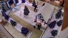 One side of shopping mall with Christmas tree decorated for xmas season stock video footage