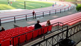 One side of sport field. Two older man talking about sport in Coqitlam BC Canada stock video