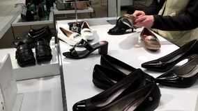 One side of woman choosing new shoes. Inside The bay store stock video