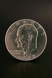 One Silve Dollar. An Eisenhower silver dollar islolated on a black background stock photo
