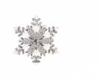 One silver snowflake isolated. One glittering silver snowflake isolated on white with copy space Stock Photography