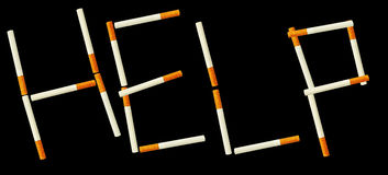 One simple cigarette in word HELP. Simple cigarettes isolated on a white background Stock Photos