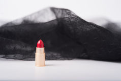 one single lipstick with lace fabric Royalty Free Stock Photo