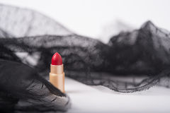one single lipstick with lace fabric Royalty Free Stock Image