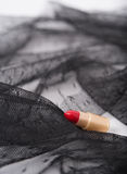 one single lipstick with lace fabric Royalty Free Stock Images