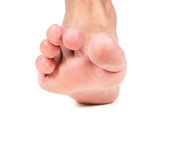 One single malefoot stepping towards white Stock Image
