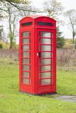 One Single Red Telephone Box Traditional Old Dial Up Pay With Coins To Call Stock Photo