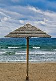 Thatched Beach  Umbrella .Isolated stock image