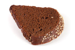 One slice of black bread with sesame seeds isolated on white background Stock Photos