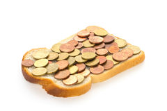One slice of bread with euro mix spread. One slice of white bread with euro coins mix spread Stock Photography
