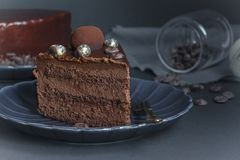 One slice of chocolate brownie cake, dessert with nuts on dark background royalty free stock images