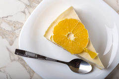 One slice of homemade orange cake on plate with teaspoon Royalty Free Stock Images