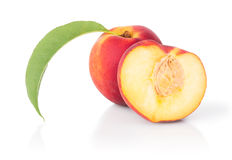 One with a slice of juicy peach Royalty Free Stock Image