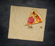One Slice of Pizza on Dark Background Royalty Free Stock Photography