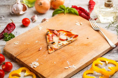 One slice of pizza Stock Images