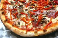 One slice taken. Pepperoni pizza is one of the well known pizzas everywhere Royalty Free Stock Photography