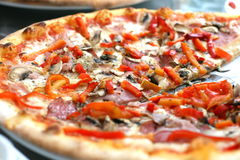 One slice taken. Pepperoni pizza is one of the most popular Stock Photo