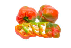 One sliced and two whole bell peppers on light background Stock Photo