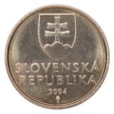 Slovak koruna coin. One Slovak koruna with the image of the coat of arms isolated on a white background Stock Photography
